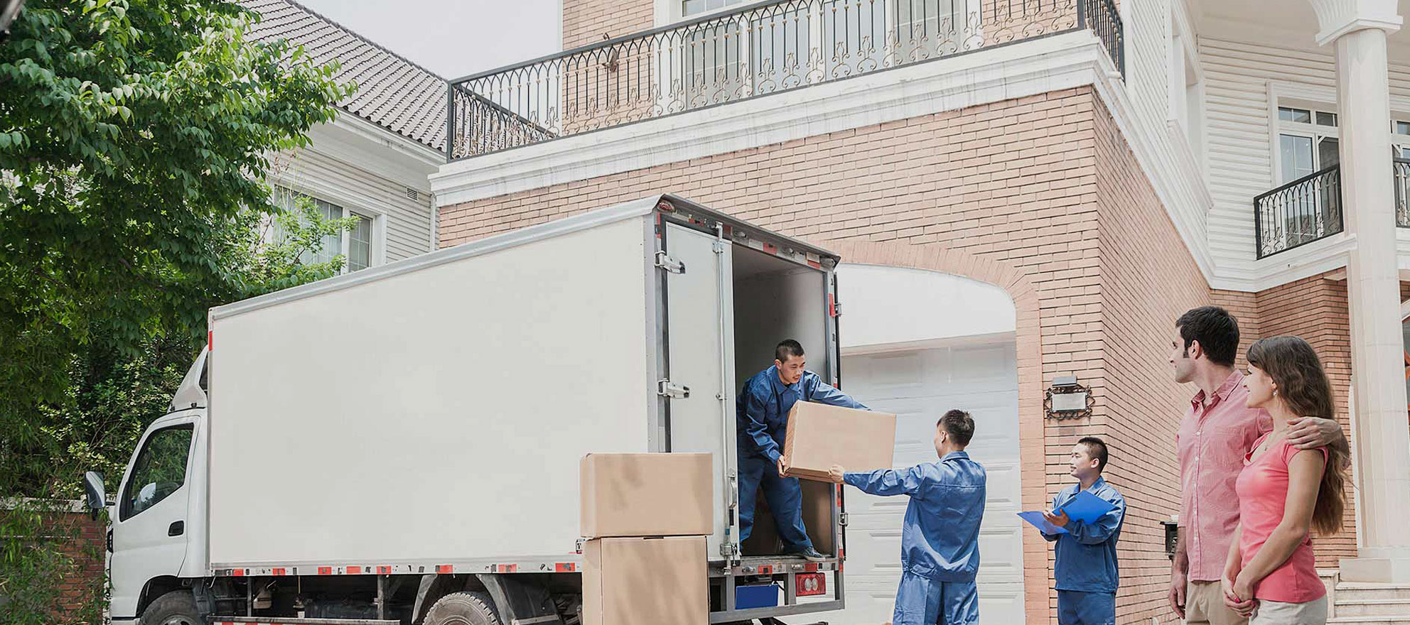 photo of professional movers packing items